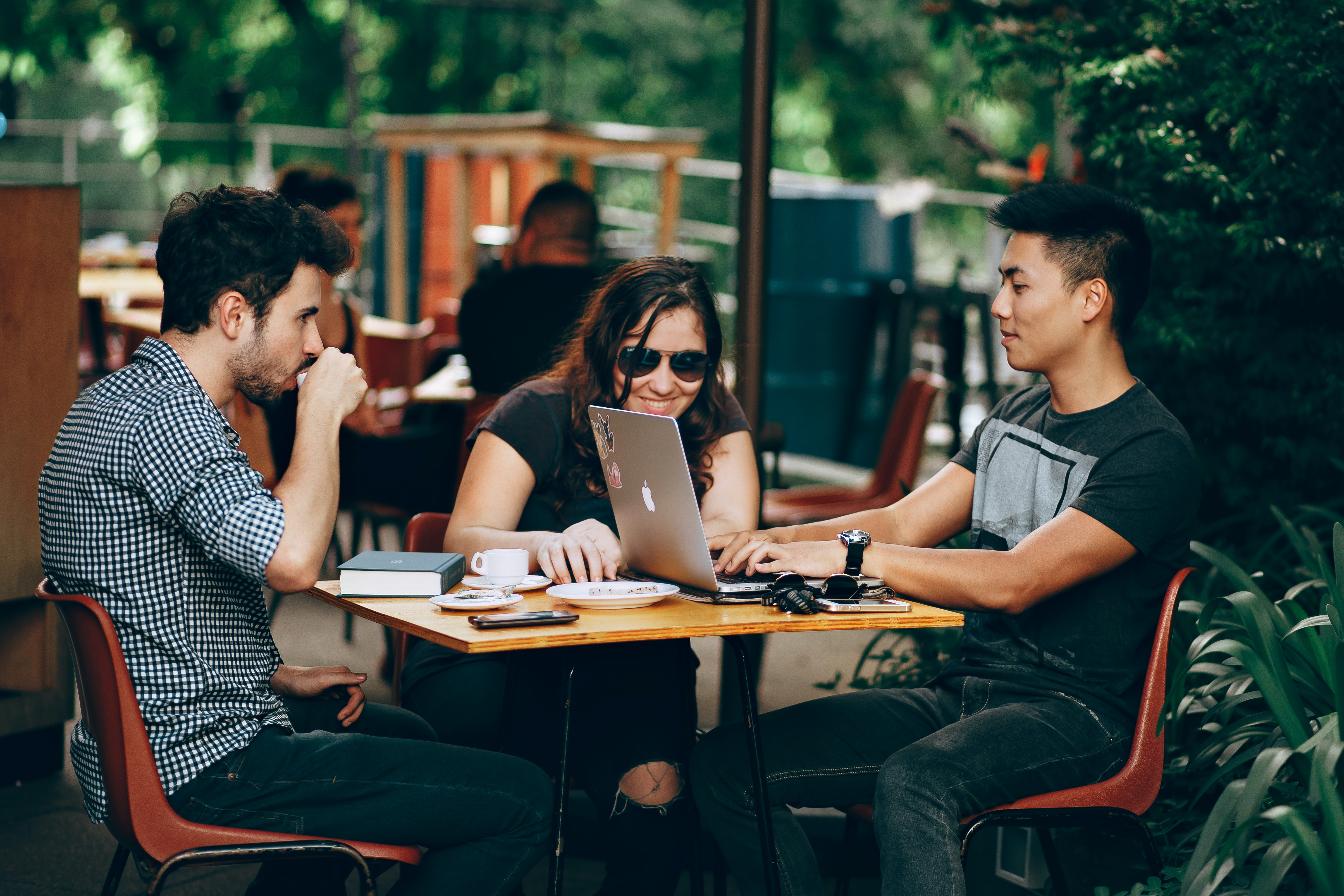 students at a table with laptops