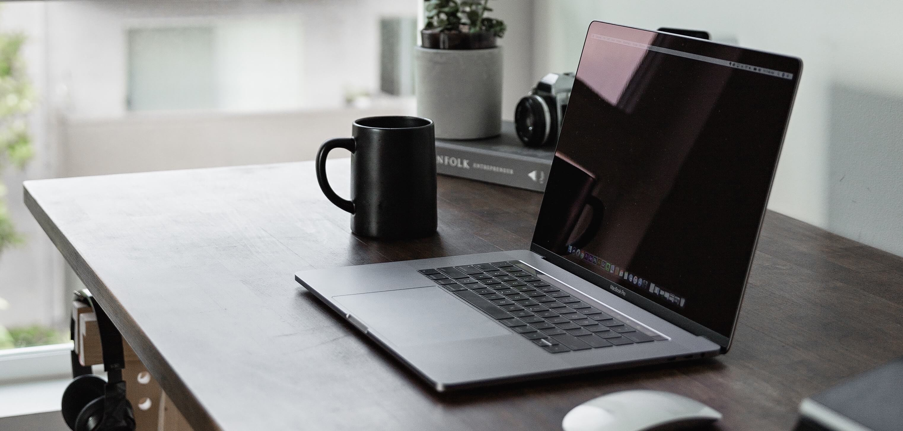 Image of laptop and coffee cup on desk