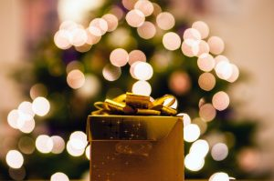 Image of present in front of tree