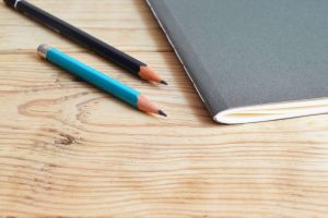 Image of notebook and pencils